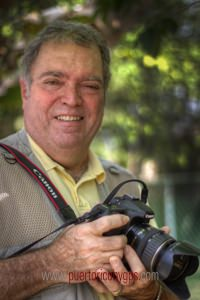 Photo of Orlando Mergal holding a Canon Camera. Courtesy of Puerto Rico by GPS.