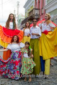 Street dancers on stilts.