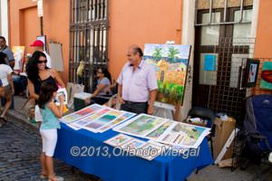 Artist selling his art on San Sebastian Street.