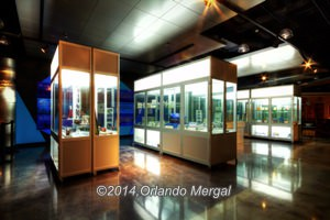 These glass cases contain all sorts of memorabilia about Puerto Ricos aviation, shipping and automotive history. Click on image to see it larger.